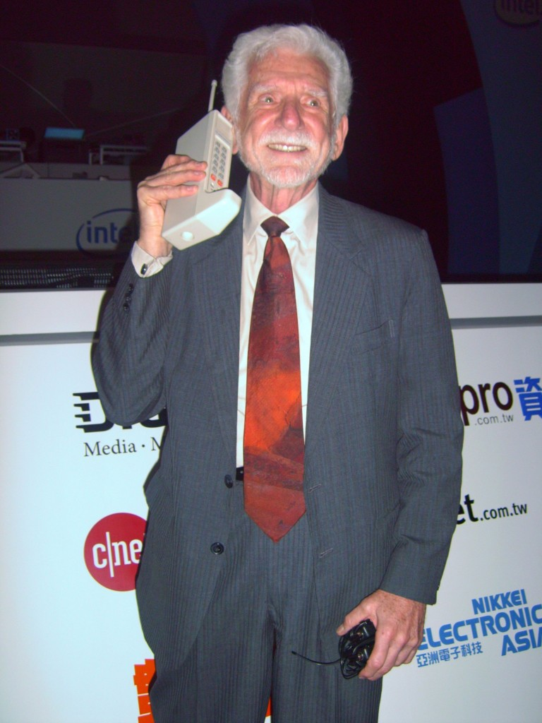 Dr. Martin Cooper of Motorola made the first publicized handheld mobile phone call on a larger prototype model on April 4, 1973. This is a reenactment in 2007.